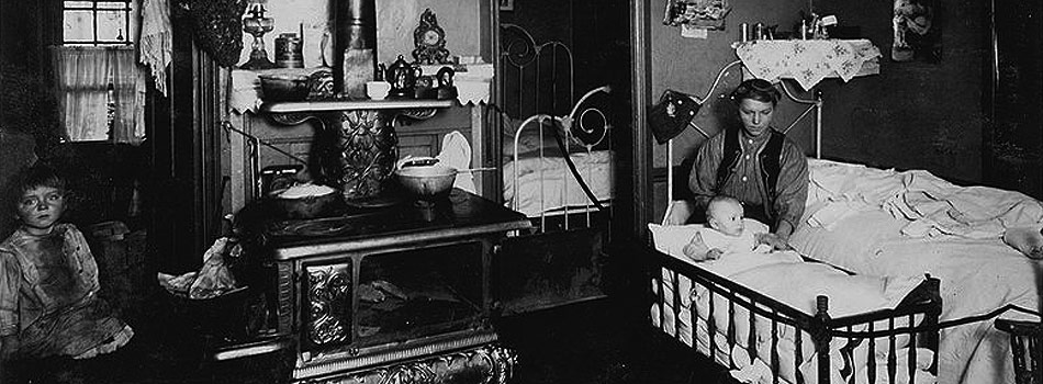 """""""Overcrowded home of workers in cotton mill, Olneyville, Providence. Eight people live in these 3 small rooms, 3 of them are boarders. Inner bedrooms are 9x8 feet, the largest room 12x12 feet. 23 Chaffee Street, Polish People. Property owned by the mill. Rent $4.50 a month"""" 1912"""