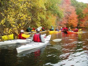 Kayakers paddle down the Blackstone River in Lincoln, RI.
