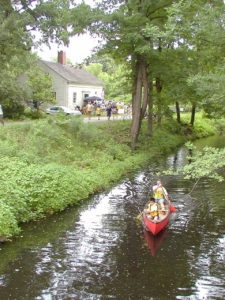 View of the Kelly House Museum and canoe on the Blackstone Canal.