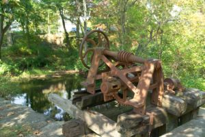 Machinery remnants on the Blackstone River that control the flow of water to power the mill at Slatersville.